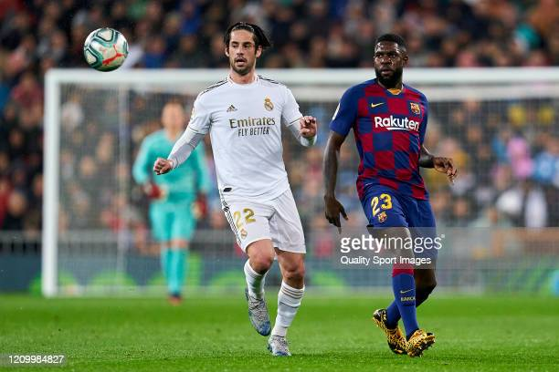 Isco Alarcon of Real Madrid CF battle for the ball with Samuel Umtiti of FC Barcelona during the Liga match between Real Madrid CF and FC Barcelona...