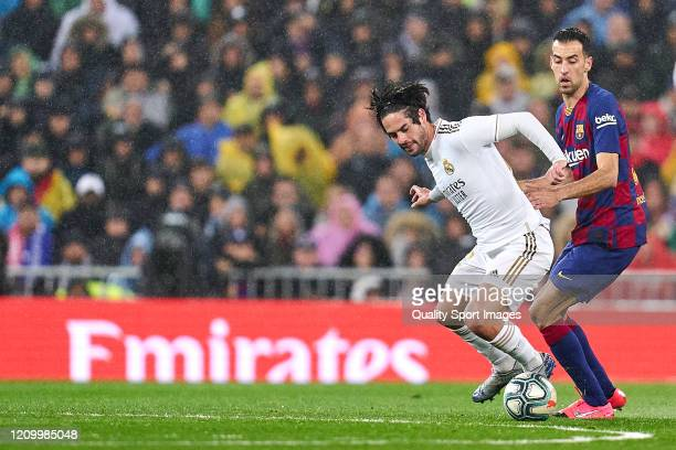 Isco Alarcon of Real Madrid CF battle for the ball with Sergio Busquets of FC Barcelona during the Liga match between Real Madrid CF and FC Barcelona...