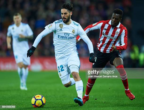 Isco Alarcon of Real Madrid CF being followed by Inaki Williams of Athletic Club during the La Liga match between Athletic Club and Real Madrid at...
