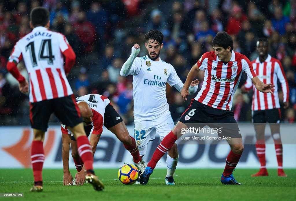 Isco Alarcon of Real Madrid CF (C) being followed by Mikel Rico of Athletic Club (L) and Mikel San Jose of Athletic Club (R) during the La Liga match between Athletic Club and Real Madrid at Estadio de San Mames on December 2, 2017 in Bilbao, Spain.