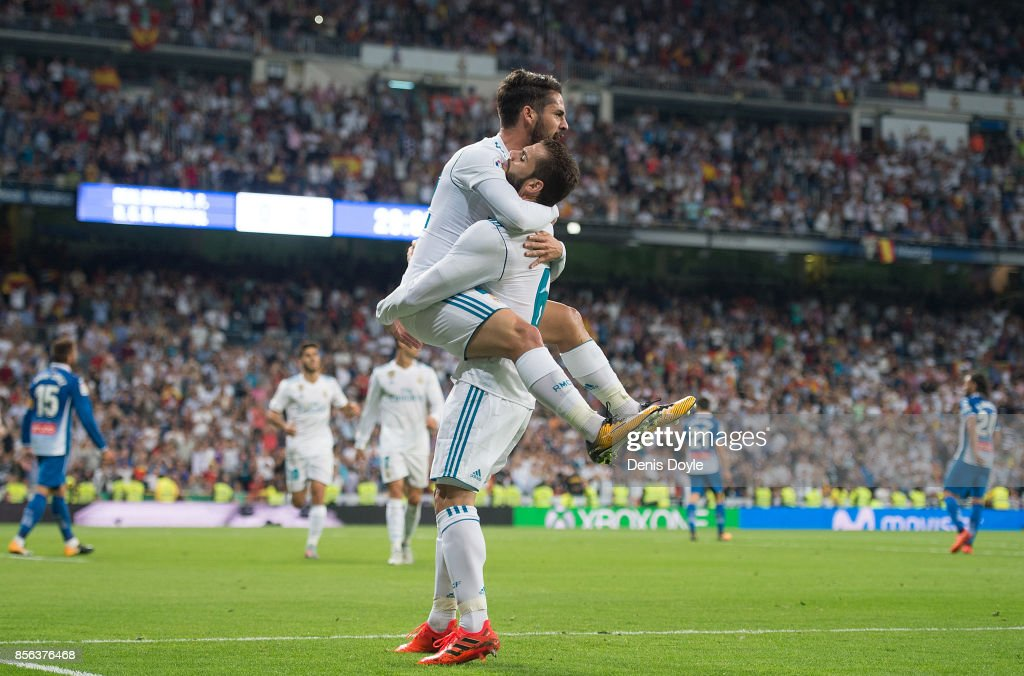 Isco Alarcon of Real Madrid CF celebrates with Nacho after scoring his teamÕs opening goal during the La Liga match between Real Madrid and Espanyol at Estadio Santiago Bernabeu on October 1, 2017 in Madrid, Spain.