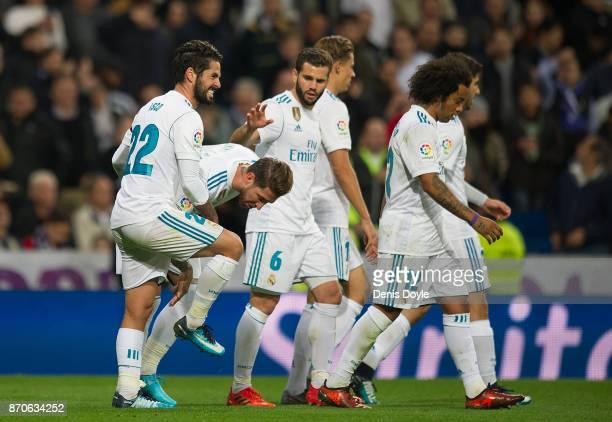 Isco Alarcon of Real Madrid CF celebrates with Sergio Ramos after scoring his team's 3rd goal during the La Liga match between Real Madrid and Las...