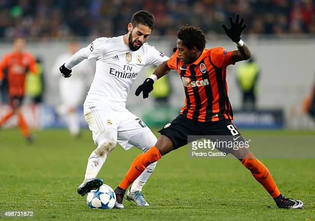 Isco Alarcon of Real Madrid CF duels for the ball with Fred of FC Shakhtar Donetsk during the UEFA Champions League match between FC Shakhtar Donetsk...