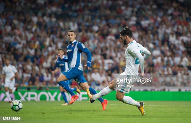 Isco Alarcon of Real Madrid CF scores his team's opening goal during the La Liga match between Real Madrid and Espanyol at Estadio Santiago Bernabeu...