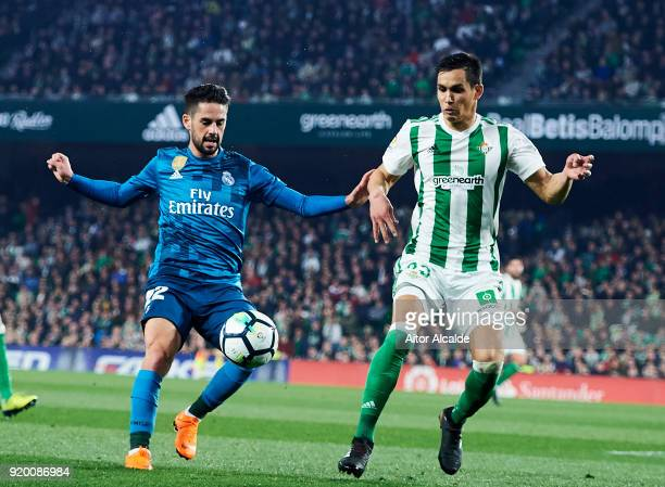 Isco Alarcon of Real Madrid competes for the ball with Aissa Mandi of Real Betis during the La Liga match between Real Betis and Real Madrid at...