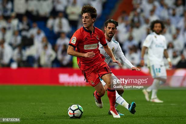 Isco Alarcon of Real Madrid competes for the ball with Alvaro Odriozola of Real Sociedad during the La Liga match between Real Madrid and Real...