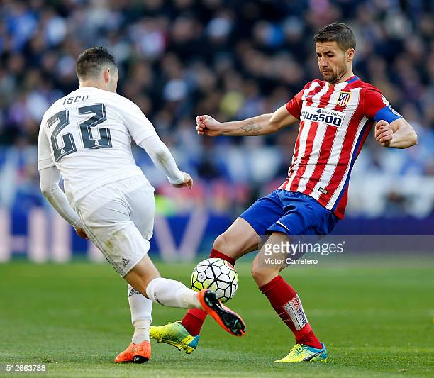 Isco Alarcon of Real Madrid competes for the ball with Gabi Fernandez of Atletico de Madrid during the La Liga match between Real Madrid CF and Club...