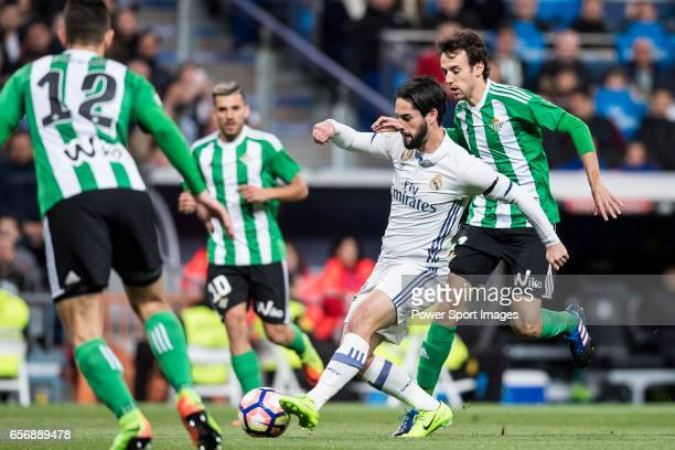 Isco Alarcon of Real Madrid competes for the ball with Ruben Pardo Gutierrez of Real Betis during their La Liga match between Real Madrid and Real...