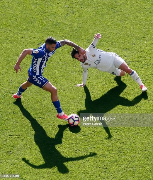 Isco Alarcon of Real Madrid duels for the ball with Edgar Mendez of Deportivo Alaves during the La Liga match between Real Madrid and Deportivo...