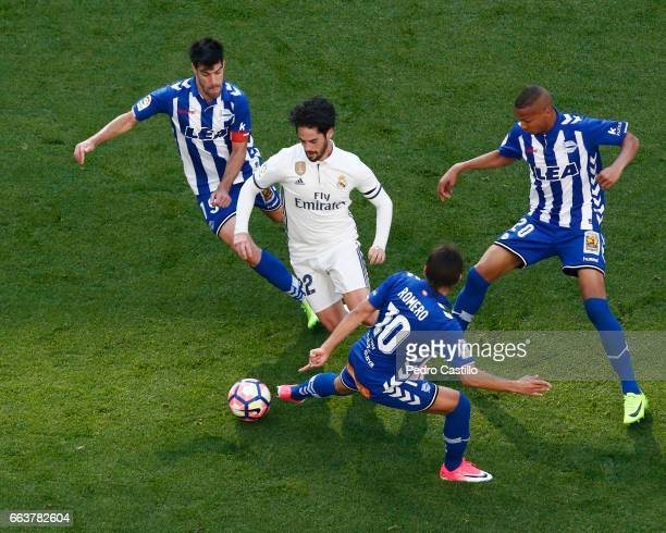 Isco Alarcon of Real Madrid duels for the ball with Oscar Romero of Deportivo Alaves during the La Liga match between Real Madrid and Deportivo...