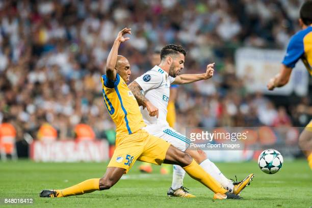 Isco Alarcon of Real Madrid fights for the ball with Carlos Roberto Da Cruz Junior Cariao of APOEL FC during the UEFA Champions League 201718 match...