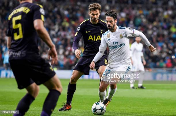 Isco Alarcon of Real Madrid fights for the ball with Fernando Llorente of Tottenham Hotspur FC during the UEFA Champions League 201718 match between...