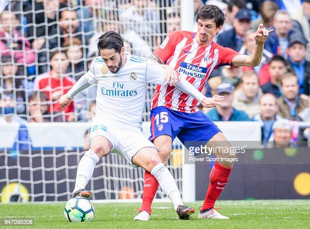 Isco Alarcon of Real Madrid fights for the ball with Stefan Savic of Atletico de Madrid during the La Liga match between Real Madrid and Atletico...