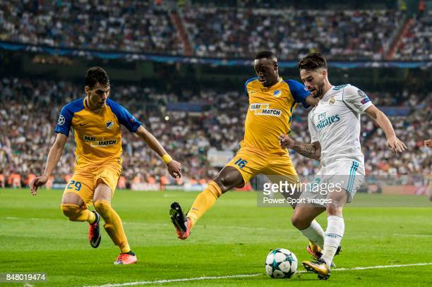 Isco Alarcon of Real Madrid fights for the ball with Vinicius de Oliveira Franco and Praxitellis Vouros of APOEL FC during the UEFA Champions League...