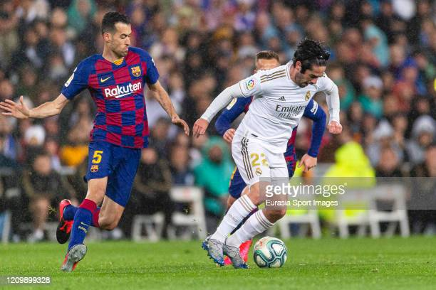 Isco Alarcon of Real Madrid is chased by Sergio Busquets and Arthur Melo of FC Barcelona during the Liga match between Real Madrid CF and FC...