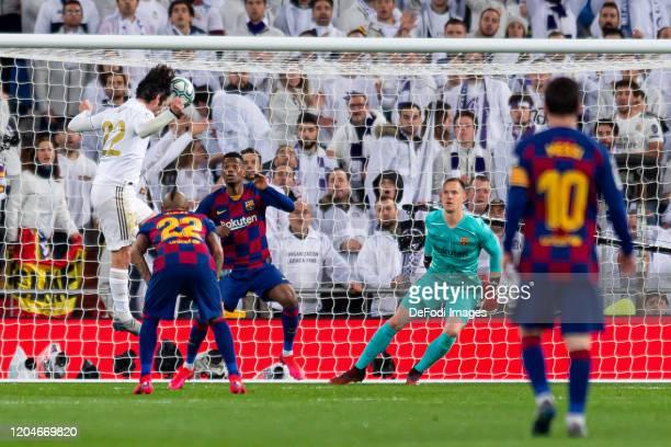 Isco Alarcon of Real Madrid Nelson Semedo of FC Barcelona and goalkeeper MarcAndre Ter Stegen of FC Barcelona battle for the ball during the Liga...