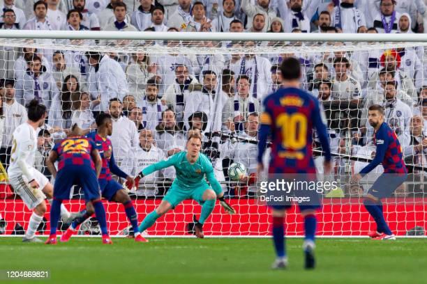 Isco Alarcon of Real Madrid Nelson Semedo of FC Barcelona goalkeeper MarcAndre Ter Stegen of FC Barcelona and Gerard Pique of FC Barcelona battle for...