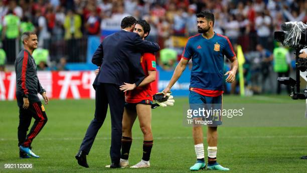 Isco Alarcon of Spain and Head coach Fernando Hierro of Spain look dejected after the 2018 FIFA World Cup Russia match between Spain and Russia at...