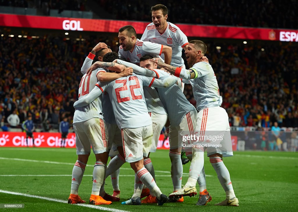 Isco Alarcon (22) of Spain celebrates after scoring his sides sixth goal with his teammates during the international friendly match between Spain and Argentina at Wanda Metropolitano stadium on March 27, 2018 in Madrid, Spain.