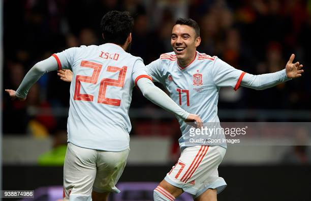 Isco Alarcon of Spain celebrates after scoring his sides third goal with his teammate Iago Aspas during the international friendly match between...