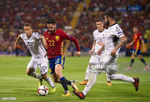 Isco Alarcon of Spain runs past Ergys Kace of Albania during the FIFA 2018 World Cup Qualifier between Spain and Albania at Estadio Jose Rico Perez...
