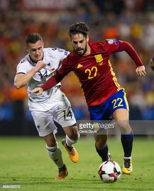 Isco Alarcon of Spain tries to fend off Taulant Xhaka of Albania during the FIFA 2018 World Cup Qualifier between Spain and Albania at Estadio Jose...