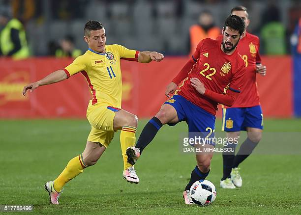 Isco Alarcon of Spain vies for the ball with Gabriel Andrei Torje of Romania during the friendly football match between Romania and Spain in Cluj...