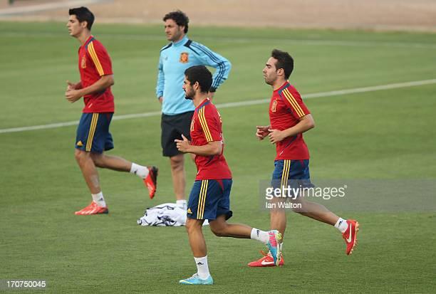 Isco and Alvaro Morata of Spain warm up during a Spain Training Session before the UEFA European U21 Championships final at Kfar Saba Stadium on June...