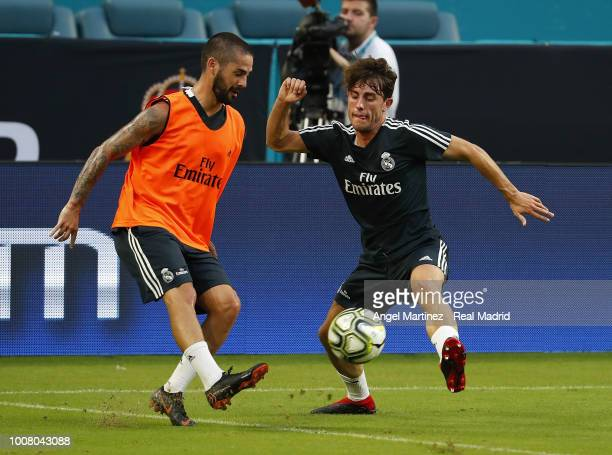 Isco and Alvaro Odriozola of Real Madrid in action during a training session at Hard Rock Stadium on July 30 2018 in Miami Florida