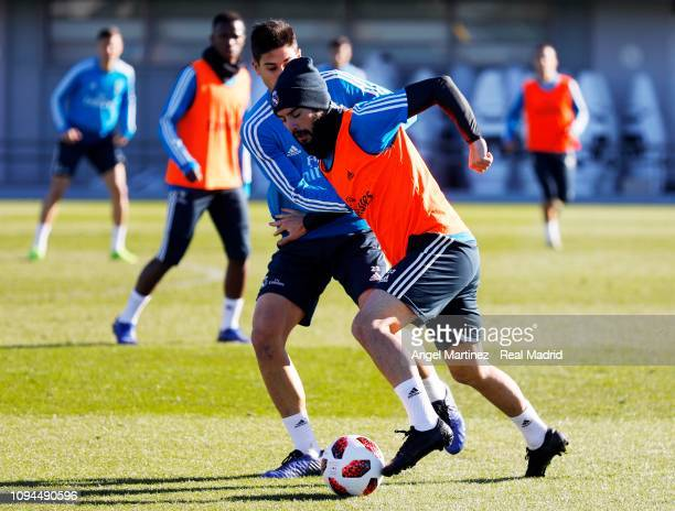 Isco and Jaume Grau of Real Madrid in action during a training session at Valdebebas training ground on January 15 2019 in Madrid Spain