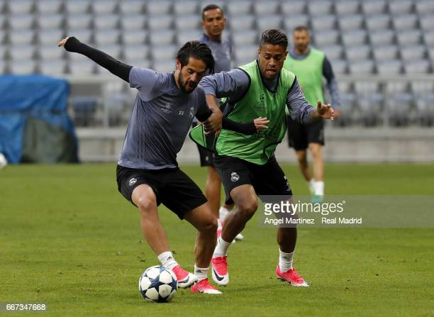 Isco and Mariano Diaz of Real Madrid in action during a training session at Allianz Arena on April 11 2017 in Munich Germany