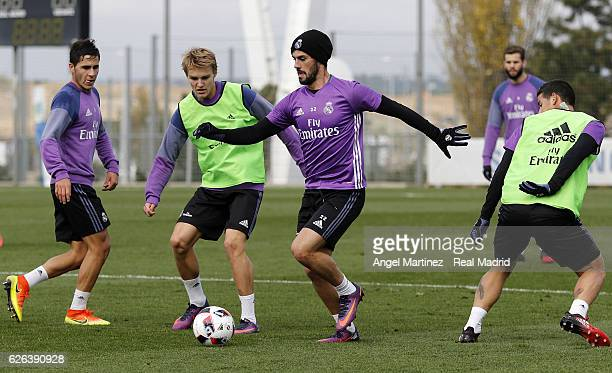 Isco and Martin Odegaard of Real Madrid in action during a training session at Valdebebas training ground on November 29 2016 in Madrid Spain
