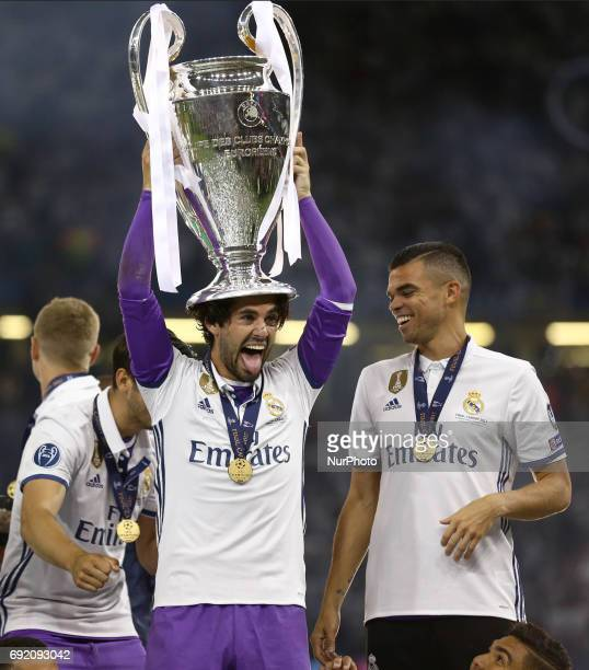 Isco and Pepe of Real Madrid with the cup during the UEFA Champions League Final between Juventus and Real Madrid at National Stadium of Wales on...