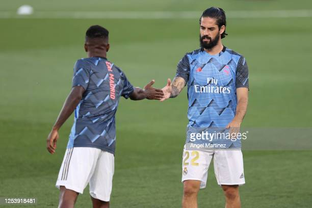 Isco and Vinicius Junior of Real Madrid warm up for the Liga match between Real Madrid CF and Getafe CF at Estadio Alfredo Di Stefano on July 02,...