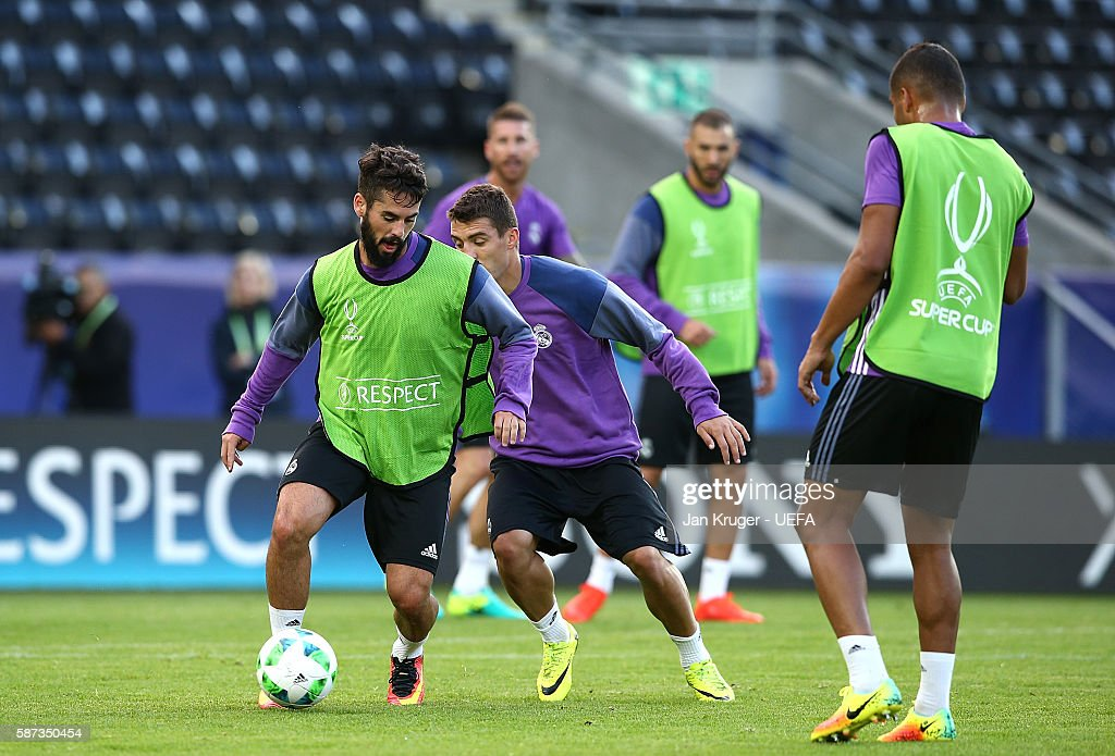 Isco battles with Mateo Kovacic during a training session ahead of the UEFA Super Cup match between Real Madrid and Savilla at Lerkendal Stadion on August 8, 2016 in Trondheim, Norway.