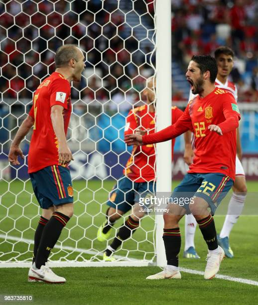 Isco celebrates with David Silva after scoring his sides opening goal to make the score 11 during the 2018 FIFA World Cup Russia group B match...