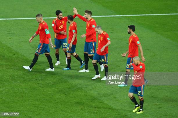 Isco celebrates with teammates after scoring his sides opening goal to make the score 11 during the 2018 FIFA World Cup Russia group B match between...