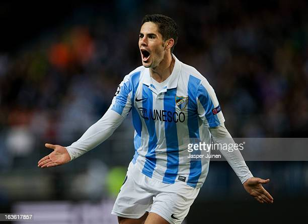 Isco of Malaga CF celebrates scoring his sides opening goal during the UEFA Champions League Round of 16 second leg match between Malaga CF and FC...