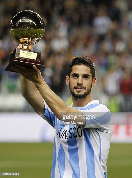 Isco of Malaga holds up the Golden Boy trophy before the La Liga match between Malaga CF and Real Madrid at La Rosaleda Stadium on December 22, 2012...