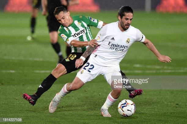 Isco of Real Madrid and Andres Guardado of Real Betis during the La Liga Santander match between Real Madrid and Real Betis at Estadio Santiago...