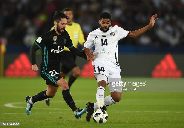 Isco of Real Madrid and Eissa Mohamed of Al Jazira battle for the ball during the FIFA Club World Cup UAE 2017 semi final match between Al Jazira and...