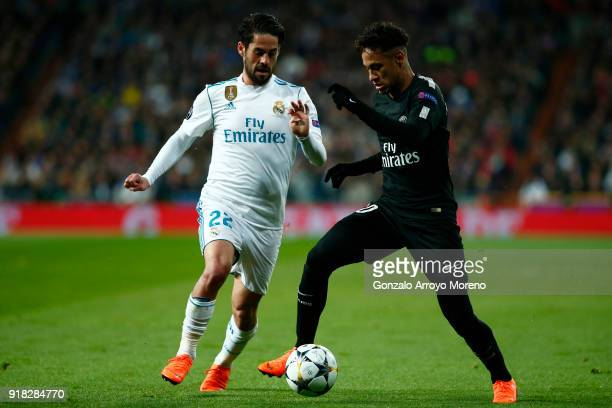 Isco of Real Madrid and Neymar of PSG in action during the UEFA Champions League Round of 16 First Leg match between Real Madrid and Paris...