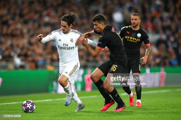 Isco of Real Madrid and Rodri of Manchester City during the UEFA Champions League round of 16 first leg match between Real Madrid and Manchester City...