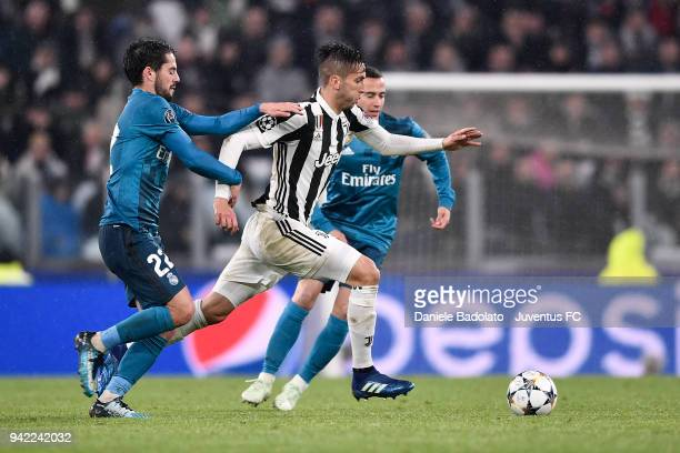 Isco of Real Madrid and Rodrigo Bentancur of Juventus in action during the UEFA Champions League Quarter Final Leg One match between Juventus and...