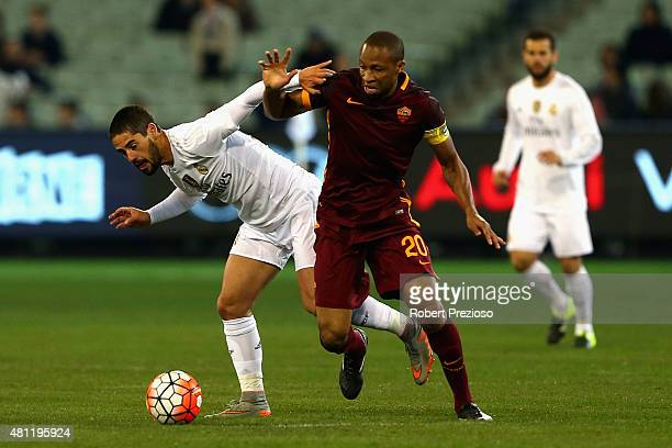 Isco of Real Madrid and Seydou Keita of AS Roma contest the ball during the International Champions Cup friendly match between Real Madrid and AS...