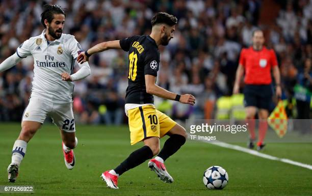 Isco of Real Madrid and Yannick Carrasco of Atletico Madrid battle for the ball during the UEFA Champions League semifinal first leg match between...