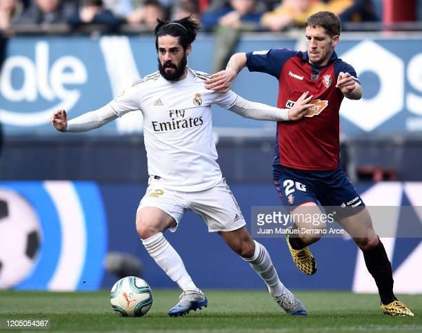 Isco of Real Madrid battles for possession with Darko Brasanac of Osasuna during the La Liga match between CA Osasuna and Real Madrid CF at El Sadar...