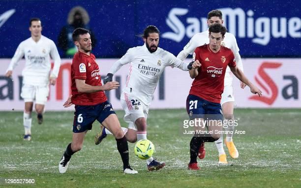 Isco of Real Madrid battles for possession with Oier Sanjurjo and Inigo Perez of CA Osasuna during the La Liga Santander match between C.A. Osasuna...