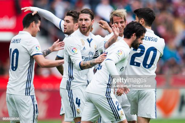Isco of Real Madrid celebrates after scoring goal during the La Liga match between Real Sporting de Gijon and Real Madrid at Estadio El Molinon on...