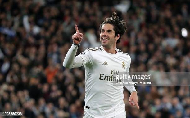 Isco of Real Madrid celebrates after scoring his team's first goal during the UEFA Champions League round of 16 first leg match between Real Madrid...